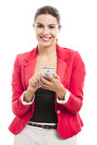 Business woman sending sms. Business woman texting someone, isolated over a white background Royalty Free Stock Photo