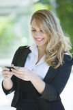 Business woman sending text message. Happy young Business woman sending text message Stock Images