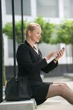 Business woman sending text message Royalty Free Stock Photo