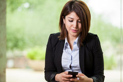 Business woman sending a text Stock Image