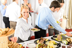 Business woman serve herself at buffet royalty free stock images