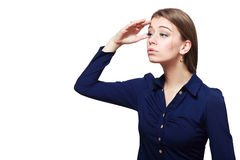 Business woman shading her eyes Stock Image