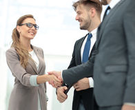Business woman shaking hand to  her  partner Stock Photo