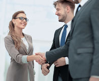Business woman shaking hand to  her  partner Royalty Free Stock Images
