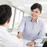 Business woman shaking hands Stock Photography