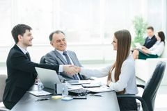 Business woman shaking hands with an adult business partner. stock photo