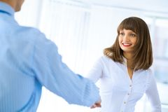 Business woman shaking hands with a client Stock Images