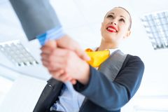 Business woman shaking hands with a client Stock Photography