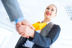 Business woman shaking hands with a client Stock Image