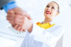 Business woman shaking hands with a client Stock Photo