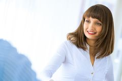 Business woman shaking hands with a client Royalty Free Stock Images