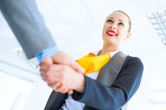 Business woman shaking hands with a client Stock Photos