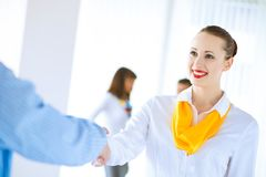Business woman shaking hands with a client Royalty Free Stock Image
