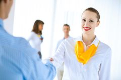 Business woman shaking hands with a client Royalty Free Stock Photo