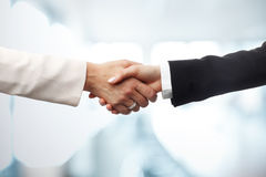 Business woman shaking hands Royalty Free Stock Images