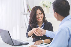 Business woman shaking hands Stock Photos