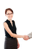 Business woman shaking male hand Royalty Free Stock Image