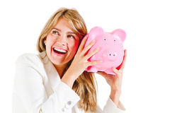 Business woman shaking a piggybank Stock Photography