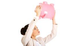 Business woman shaking piggybank. Stock Images