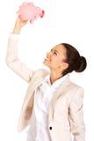 Business woman shaking piggybank. Royalty Free Stock Photo