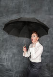 Business woman sheltering Stock Photo