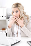 Business woman shocked - crashed laptop at workplace Royalty Free Stock Photo