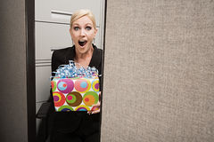 Business woman shocked by present Royalty Free Stock Photos