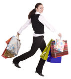 Business woman with shopping bag run. Stock Image