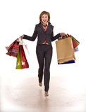 Business woman with shopping fly over  earth. Isolated Royalty Free Stock Image
