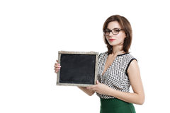 Business woman with short hair wearing glasses holding a card. Stock Images