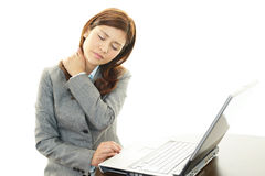 Business woman with shoulder pain. Royalty Free Stock Photography