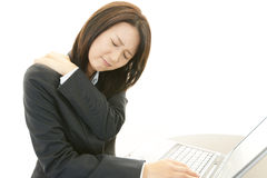 Business woman with shoulder pain. stock image