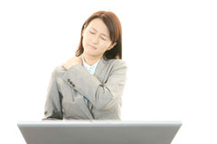 Business woman with shoulder pain. Royalty Free Stock Images