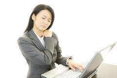 Business woman with shoulder pain. Stock Photography