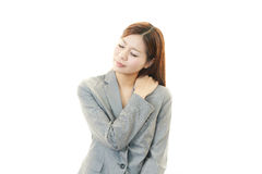 Business woman with shoulder pain. royalty free stock photos