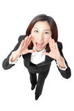 Business Woman Shouting. Isolated over a White Background, funny shot from high view, model is a asian beauty Royalty Free Stock Image
