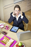 Business woman shouting having conversation with two phones driving crazy Stock Photography
