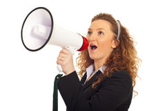 Business woman shouting into loudspeaker Stock Image