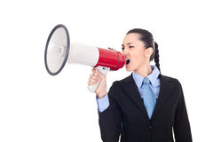 Business woman shouting into megaphone Stock Photography