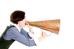 Business woman shouting into a megaphone Royalty Free Stock Images