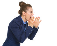 Business woman shouting through megaphone shaped hands Royalty Free Stock Image