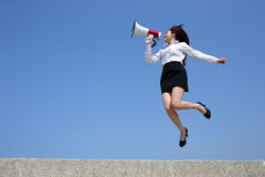 Business woman shouting megaphone Royalty Free Stock Photo