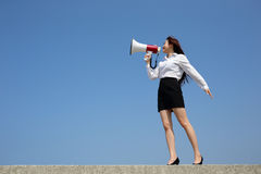 Business woman shouting megaphone. Successful business woman shouting in megaphone with blue sky background, full length, asian Stock Photography