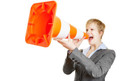 Business woman shouting in traffic cone Stock Image