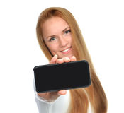 Business woman show blank mobile cell phone. Business woman show blank card or mobile cell phone display with black screen on a white background. Focus on the royalty free stock photos