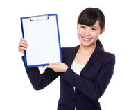 Business woman show with clipboard Royalty Free Stock Photos