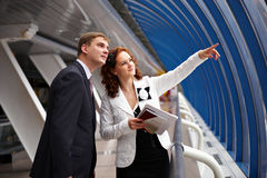 Business woman show the side your partner. Young business woman shows her partner promising place for the construction of the facility Royalty Free Stock Images