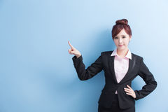Business woman show something. Business woman is smile and show something to you with  on blue background, asian Royalty Free Stock Image