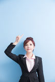 Business woman show something. Business woman is smile and show something to you with on blue background, asian stock images