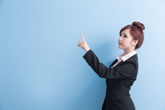 Business woman show something. Business woman is smile and show something to you with isolated on blue background, asian Royalty Free Stock Photo